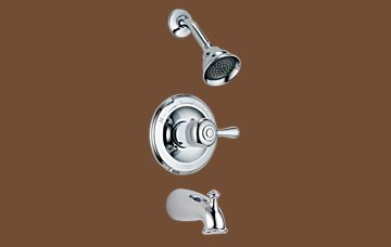 Photograph Of Shower Set With Spout, Single Grasp Handle And Shower Head.